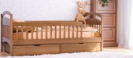 Детские кровати с бортиками различной конструкции и их особенности