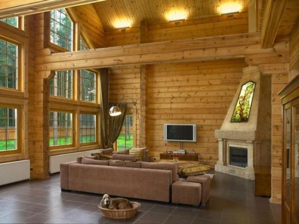 Фото дизайна интерьера гостиной в загородном деревянном доме с камином